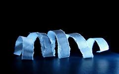 Just White Paper / Seulement du papier blanc (M. Carpentier) Tags: macromonday justwhitepaper light lumière blanc bleu white blue papier feuillesheet noir black twisted enroulé