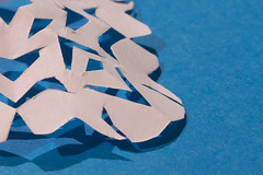 Paper Snowflakes (Marcy Leigh) Tags: hmm macro macromondays justwhitepaper whitepaper paper white snowflakes papersnowflakes stark negativespace shadows shadow shapes 117picturesin2017 childishdelights cut scissors fun