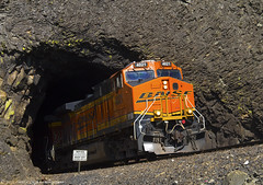 Blasting out of Tunnel Two (Patrick Dirden) Tags: railroad cliff rock train washington garbage northwest diesel engine rail tunnel columbiariver pacificnorthwest locomotive ge pnw freight bnsf basalt columbiarivergorge generalelectric freighttrain underwood burlingtonnorthernsantafe skamaniacounty c449w bnsfrailway wsdot bnsfrailroad sr14 dranolake garbagetrain columbiarivernationalscenicarea burlingtonnorthernsantaferailroad bnsf4021 dranolaketunnel underwoodwa bnsffallbridgesubdivision