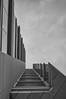 i·sos·ce·les (Jovan Jimenez) Tags: canon eosm3 eos m3 efm 22mm vancouver building vertical architecture mono black white monochrome monochromatic gray triangle isosceles shapes windows up nik collection silver effect pro