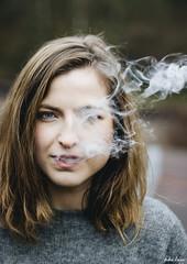 Y si el placer fuera sólo ausencia de dolor... (Andrea Latasa) Tags: portrait retrato face mood smoke eye 50mm book detail beauty different artistic young women girl