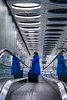 Flight Attendant (BasLoo) Tags: flight attendant steward blue klm stairs escalator shiphol airport airportstreetstyle light reflection ipad travel flying suitcase canon 450d tamron 18270mm f3563