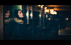 Miles Apart (One_Penny) Tags: bayern deutschland germany münchen bavaria canon munich night photography portrait girl woman lights urban town city cinematic cinema film movie tones cineast lookslikefilm moment expression bokeh colors reflection sad depthoffield 135f2 canon6d portraiture light window
