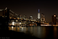 View of Brooklyn Bridge and downtown Manhattan4 (kale.amit) Tags: nyc newyorkcity longexposure ny newyork canon reflections us downtown shadows skyscrapers manhattan bridges citylights brooklynbridge hudsonriver hudson bigapple glassofwater oneofmybest nighstscape