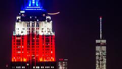 Vivid New York / Empire States Building + WTC (hiroshiken) Tags: city newyork building skyline night observation manhattan worldtradecenter deck metropolis empirestatebuilding wtc topoftherock rockfeller