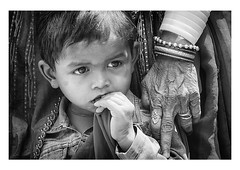 generations together (handheld-films) Tags: travel family boy portrait people blackandwhite india closeup children mono togetherness eyes asia child arms faces grandmother indian young documentary grandson portraiture aged safe generations closeness society relationships rajasthan reportage safeplace subcontinent ruralindia