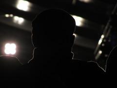 Man of shadow (shaggy359) Tags: cambridge light shadow man hat silhouette festival dark cherry audience folk outline cambridgeshire hinton cambs 2015