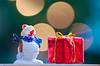 For Me? (mpardo.photo) Tags: present snowman miniature macro closeup bokeh christmas pentaxart darktable gimp cc0 hmm macromondays holidaybokeh