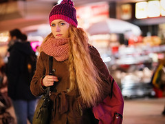 (graveur8x) Tags: woman candid street portrait girl germany offenbach frankfurt deutschland winter hat blond blueeyes night lights reflections people outdoor dof bokeh streetphotography cold late evening beautiful olympus olympusm75mmf18 lumix