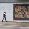 colliding with color (jimATL (weltreisender2000)) Tags: man pedestrian smartphone sidewalk multicolored wall tile art street atlanta explored