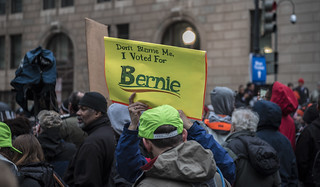 Don't Blame Me, I Voted for Bernie - A Protester Holds a Sign Outside the Presidential Inauguration of Donald Trump