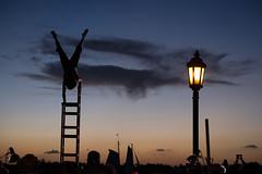 Head Under Heels (BrianEden) Tags: travel sunset silhouette keys chair unitedstates florida tricks streetperformer acrobat fl handstand ladder keywest mallorysquare babymoon fujixpro1 brianedenphotography
