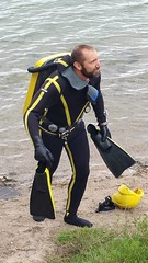 Cousteau yellow striped wetsuit with double hose regulator, helmet, striped fins and triple tanks. (Vintage Scuba) Tags: ocean lake man men wet water yellow vintage belt tank mask helmet smooth stripe dry scuba diving rubber double hose suit strap hood diver beavertail weight striped drysuit fins wetsuit rebreather jaques regulator cousteau neoprene