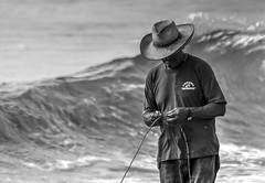 Fishing Day (Dwight Trautmann) Tags: travel people bw beach peru water azul person mar waves sony sigma playa cerro oceano ocen