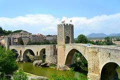Besalu bridge (Clare-White) Tags: old bridge sky water spain nikon village arches flags catalonia besalu top20bridges