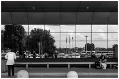 heads down (louys:) Tags: street reflection cars photographer reader sony flags selfie milanmalpensa dscrx100m3