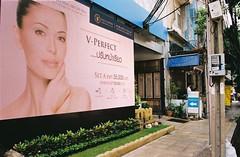 V - Perfect (jcbkk1956) Tags: street woman film beauty face analog 35mm poster thailand kodak bangkok stickers contax salon streetfurniture clinic electronic vivitar advertisment cosmetic thonglo