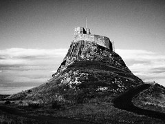 Holy Island Castle (cycle.nut66) Tags: sky blackandwhite castle art film monochrome clouds island four path olympus holy filter national micro trust grainy grayscale thirds evolt crag epl1 mzuiko beblow