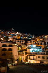 Up the hill (photographyzimbo) Tags: 2017 201701 color gear mexico sonyalpha7rii taxco when why zeissbatis25mmf20 blue building camera city cityscapephotography holidays lamp landscape lens light longexposure nightphotography orange sculpture seasons wall warmcolors weekendtrip white wideangle winter yellow