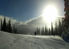Changeable weather, dramatic views (Ruth and Dave) Tags: catrin skier child sunpeaks sunburst todmountain skiresort piste skirun skiing weather weatherphotography clouds sky sun wind snow blowing backlit dramatic trees silhouette