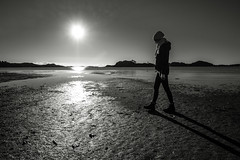 Planet Girl (PetterPhoto) Tags: petterphoto january søgne åros beach playa plage woman lonely sun strange planet walk moonwalking monochrome blackandwhite noiretblanc
