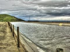 California Aqueduct (Joe Lach) Tags: californiaaqueduct aqueduct water waterpictorial flowingwater river stream clouds storm fence mountain waterwars dirt losangeles quartzhill joelach