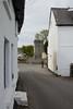 008-20150517_Vale Glamorgan-Heritage Trail 5-Llancarfan Village-looking Nwards through Village to Churchyard and Tower of Church (Nick Kaye) Tags: church southwales wales landscape village glamorgan llancarfan valeglamorgan