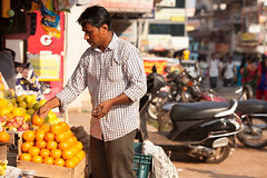 Man Picking Fruit at Market (AnniversaryRoad) Tags: asia canon5d canon5dmkii eastindian india indian karnataka udupi buying canon city color colour digital fruit man market outdoor outside people sigma street streetphotography telephoto zoom