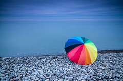 waiting (_Matt_T_) Tags: lakeontario nd8 rocks smcpda1224mmf40edalif gravel prop beach umbrella af540fgz longexposure le cactusv6 stones formatthitechsoftgradnd09 88