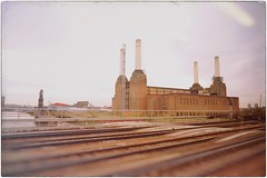 Life is a Train, Not a Station (Steve Lundqvist) Tags: power electric electricity station energy london londra england inghilterra uk kingdom railway train urban city town urbanlandscape street railroad road streetphotography color vintage pink floyd animal pig pigs battersea view nikon 24mm cimney ciminiera camino inquinamento pollution ambiente energia elettrico elettricità environmental open abandoned factory fabbrica decay brik wall work worker dust smoke fumo polvere compo composition reflection mood