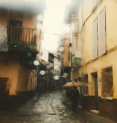 The dark song (Sator Arepo) Tags: wet rain mystery umbrella canon drops spain alley 5d slippery markii extremadura 1635mm lavera valverdedelavera