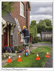 Fireman on a ladder (Paul Simpson Photography) Tags: rescue plants house grass hose fireman ladder emergency trafficcones scarecrows appleby firebrigade 999 fireservice scarecrowfestival emergencyservices photosof imageof photoof imagesof houserescue sonya77 paulsimpsonphotography august2015