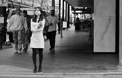 Cappuchino Time (burnt dirt) Tags: houston texas downtown mainstreet city town street streetphotography girl woman people person bw asian cappuchino coffee starbucks sidewalk wall building stockings white black standing waiting
