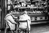 The local butcher (Culinary Fool) Tags: night october women lazio crowd restaurant italy cobblestone 2016 dinner rome alfresco man 18135mm bw brendajpederson butcher italia market sancosimatomarket blackwhite stranger trastevere culinaryfool roma