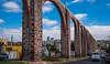 2016 - Mexico - Querétaro - Aqueducto 2 of 4 (Ted's photos - For Me & You) Tags: 2016 cropped mexico queretaro santiagodequeretaro tedmcgrath tedsphotos tedsphotosmexico vignetting nikon nikonfx nikond750 aqueducto queretaroaqueducto aqueductoqueretaro queretaroaquduct arches streetscene street vehicles unesco unescoworldheritagesite