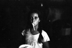 Pietanze ipnotiche (Gattacicova92) Tags: street ltm italy white black film rollei analog canon vintage 50mm italia child documentary rangefinder spoon iso 1600 bianco nero analogica sud reportage bambina cucchiaio pellicola canonrangefinder rullino filmisnotdead meridione telemetro canonvt rpx400 canonvtdeluxe believeinfilm