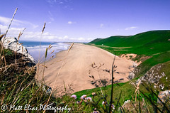 Rhossili through the tall stuff (mr_mattelias) Tags: sea sky beach nature water beautiful grass swansea southwales wales landscape coast seaside sand looking view angle natural outdoor wide vista gower through peering rhossili cliffface lowlevel rhossilibay