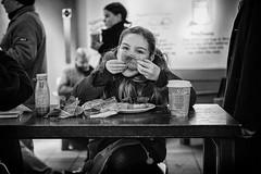 Street portrait - The girl with the bagel (Daz Smith) Tags: dazsmith fujixt10 fuji xt10 andwhite bath city streetphotography people candid canon portrait citylife thecity urban streets uk monochrome blancoynegro blackandwhite mono young girl bagel fodd eat eating coffeeshop sitting