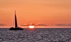 Heading Towards the Night (brev99) Tags: waikiki sailboat sunset sun ocean cameracorrectionfilter perfecteffects10 ononesoftware topazdenoise nikviveza sigma1770os d90 hawaii oahu