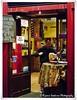 L1090582 (Rio_No) Tags: cafe spain madrid streetphotography digilux 2 leica urban sidewalk night sign