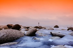 Welcome to Mars (yarin.asanth) Tags: strange foreign atmosphere lakeconstance bodensee friedrichshafen january gerdkozik yarinasanth water cold shore mars orange winter ice bolders lake