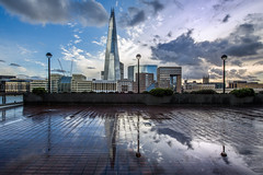Shards Of A Reflected Landscape. (Andy Bracey -) Tags: bracey andybracey andybraceyphotography nikon london londonbridge number1londonbridge theshard shard icon iconic cathedral storm stormy rain puddles reflection reflected landscape cityscape bankside river thames riverthames clouds windows buildings england greatbritain southwalkcathedral mirrored mirror shardsofareflectedlandscape