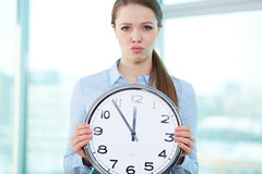 Short of time (ideacanal) Tags: people person lifestyle caucasian woman lady female expression upset unhappy sad emotion holding clock time concept conceptual looking grimacing grimace closeup deadline hurry formal employee trouble problem failure corporate indoor office fail countdown hour disappointment disappointed annoyed pout frustrated young adult attractive pretty company job occupation one elegant ideacanal