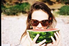 thirsty (Kevin Orbitz) Tags: ladies summer woman beach girl beauty sunglasses 35mm french nikon watermelon 35mmfilm girlsonfilm filmphotography filmroll nikon70 filmisnotdead kodakcolor kodakcolorplus