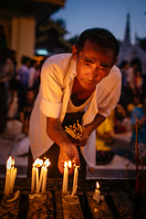 Shwedagon Festival, Yangon, Myanmar (syukaery) Tags: trip travel people man festival asian religious temple march lowlight nikon worship asia candles fuji locals buddha yangon burma faith 28mm religion culture buddhism landmark d750 ritual myanmar activity nikkor provia rangoon humaninterest vsco tabaung vscofilm