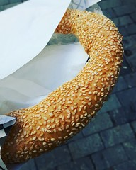 koulouri a circular bread, typically encrusted with sesame seeds. A delicious snack when browsing the streets of Athens. For the price of 70 cents   #greece💙 #greece2017 #greece #greece #greece💙 #greecestagram #greekfood #greek #pret (continentchasers1) Tags: koulouri pretzel tastyfood athens tasty greek greece2017 greekfood yummyfood greecestagram greece snacks delicioso yummy