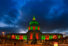Holiday Lights Under the Stormy Sky (Nualchemist) Tags: sanfrancisco cityscape cityhall clouds urban water buildings illumination lights cloudy wideangle panoramic reflection twilight bluehour night nightsky architecturalbeauty architectural landmark majestic vantagepoint slowshutterspeed alluring illuminating iconic exterior sunset architecturalphotography california building architecture eveninglight winter sky front red colorful green christmas christmasimage dreamy colorfullights colorfulillumination evening sanfranciscodowntown nightcityscape lighttrails lively decoration decorative christmasdecoration christmastree yellow blue trafficlights street cars season seasonal holidayimage holiday magical