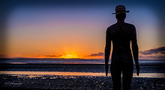 The first sunset of 2017. Crosby Beach in Liverpool. The iron man posed as my model. (arrancphotography) Tags: landscape photography photographer liverpool ironman antonygormley sunset