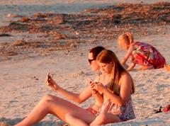 Ignoring the Sunset (mikecogh) Tags: glenelg sunset phones addicted beach sunlight child playing