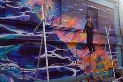 Dedication (mcginley2012) Tags: busker tightrope wire rope graffiti finbar247 street streetart streettheatre fiddle cameraphone lumia1020 unusual skill talent music fun artist violinist violinistonatightrope strange